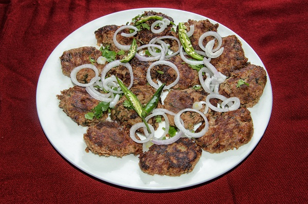 Galawati Kabab is a traditional Awadhi recipe popular in Lucknow. The word 'Galouti' or 'Galawati' means ' melt in the mouth'. Travel to Lucknow to savour the kebabs. According to an old saying Galawati Kabab was specially created for the aging Asaf-ud-daulah, who had weak teeth but he was a meat lover. This recipe is made up of minced mutton meat. It is said that the authentic Awadhi recipe used more than 150 spices to make this one kebab. This mouthwatering dish is pride of Lucknow and served across country.